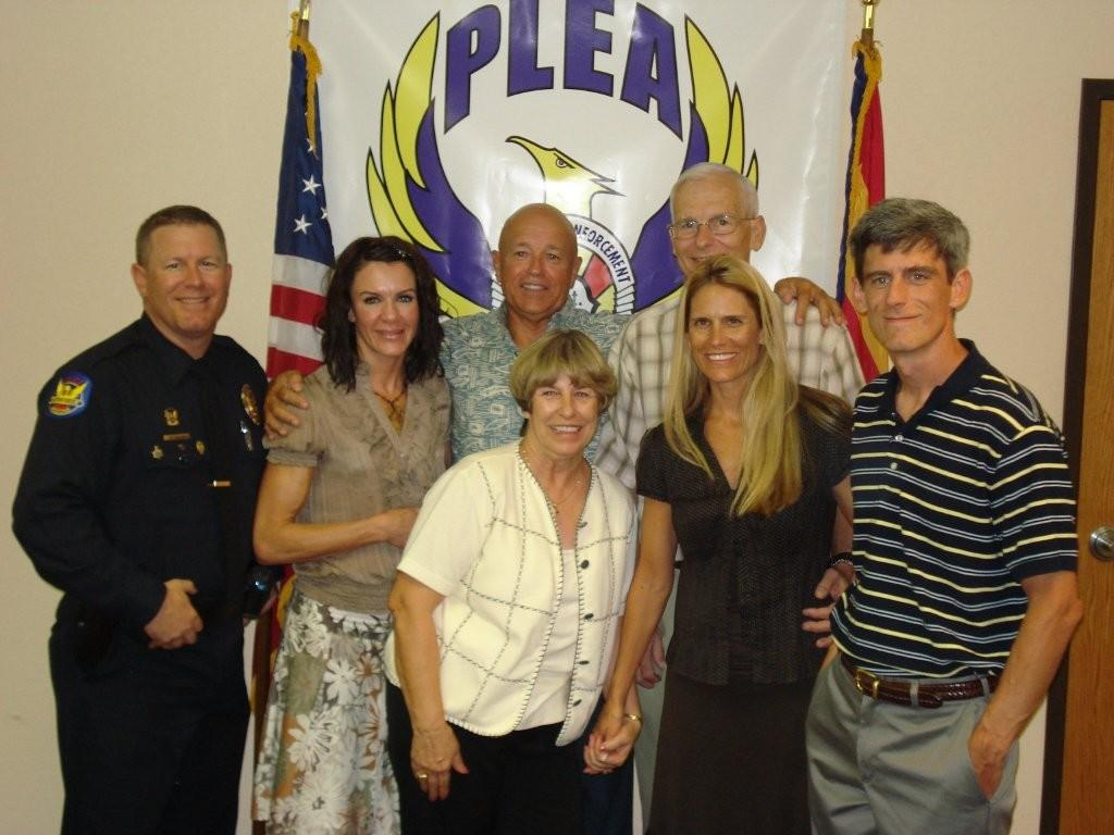 Pictured with the Galus family are the PLEA Partner Award recipients:  2nd from left Brenda Fratus and center Max Hiatt.  To the right of Max in the back row is Jim Galus whose life Brenda and Max saved. The Galus family from left to right are:Officer Bill Galus, Phyllis (mother - center), Jennifer (sister), and far right Steve Galus (brother).